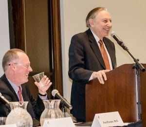 Dr. Gallo, right, speaks at a PC Centennial Presidential Speaker Series panel discussion in March 2017. At left is panelist Paul Farmer, M.D., co-founder of Partners in Health.