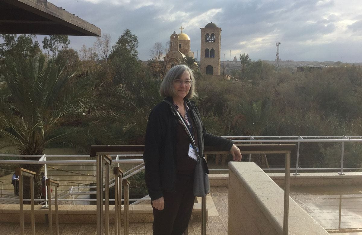 Dr. Mary O'Keeffe stands alongside the Jordan River, rear, during her fellowship trip to Israel. The river is believed to be where Jesus was baptized.
