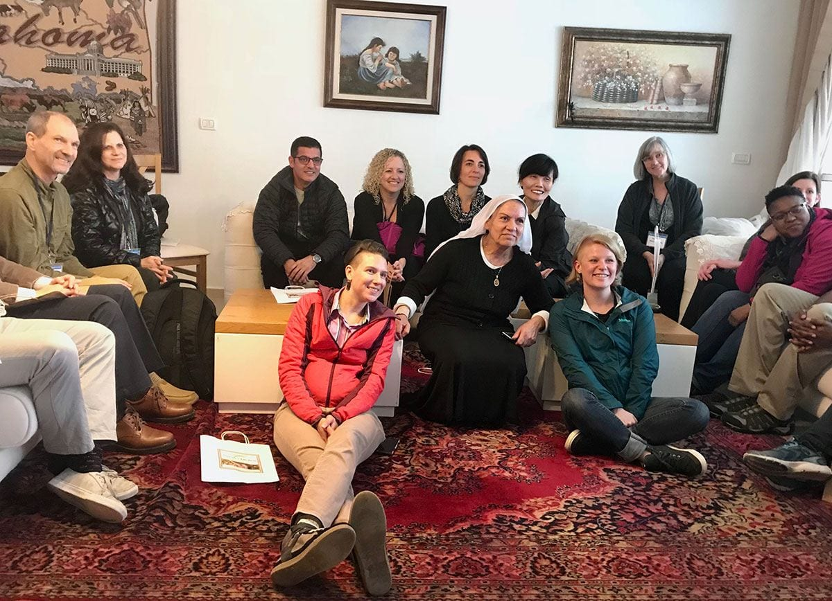 Dr. Mary O'Keeffe, sitting at rear right, joins fellowship faculty colleagues at the home of Nurah Huseyce, an Arab Israeli who owns a restaurant in the Druze town of Daliat el Carmel, Israel.