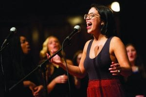Janelle Ortega '17 sings with other members of Anaclastic at the alumni a cappella concert.