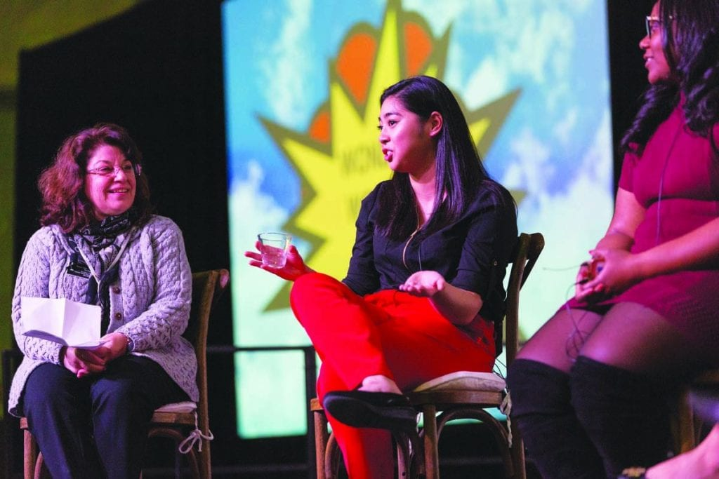 """Karen Monti Flynn '80 & '15P, president of the National Alumni Association, left, listens as Marcie Mai '18, president of the Board of Multicultural Affairs, center, speaks during the """"Wonder Women of PC"""" panel. At right is Phionna-Cayola Claude '18, Student Congress president."""