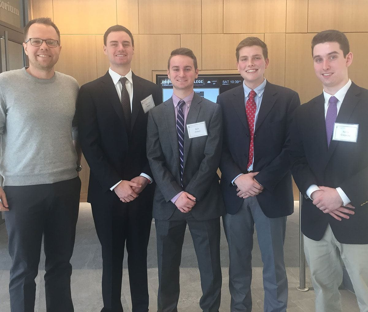 Adviser Dr. Marcin Krolikowski, assistant professor of finance, left, stands with the winning team he mentored in this year's Michael Smith Ethics Case Competition. Students are, from left, Thomas Kelly '20, Zach Aldieri '20, Jack Cassidy '20, and Kerry Crepeau '20.