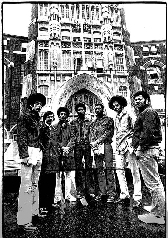 The Class of 1972, which entered PC in September 1968, included 11 black students — the largest number in College history to that date. One reason for the increase was the new Rev. Martin Luther King, Jr. Scholarship Program. Seven of the 11 students are shown outside Harkins Hall. From left are Gregory Wigley '72, Renaldo Bantum '72, Albert L. Cooks '72, Gary Wilkins '72, Donald Lewis '72, Anthony V. Rocha '72, and Wallace Johnson '72. Wigley, Bantum, Cooks, and Rocha were MLK Scholars.