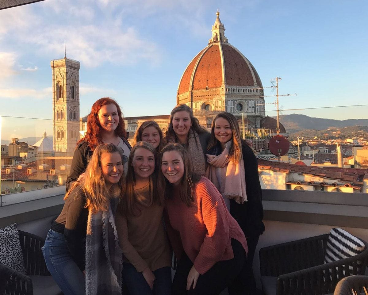 PC student teachers gather on a hotel rooftop to take in a 360-degree view of Florence on one of their last nights there during the Fall 2017 semester. They are, front row. from left: Gabrielle Farino '19, Lauren Barrett '19, and Anne Vernon '19. Second row: Molly Powers '19, Ysabelle Errico '19, Lauren Minerva '19, and Julia Miller '19. Behind them is the Cathedral of Santa Maria del Fiore.