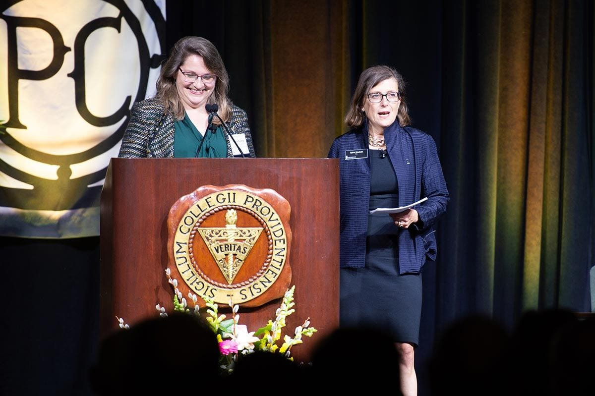 Dr. Sylvia Maxfield, right, dean of the School of Business, and Dr. Sandra T. Keating, associate professor of theology and director of the Development of Western Civilization Program, introduced Fiorina.