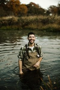 Dr. Jonathan L. Richardson, assistant professor of biology, in the water in Warren.