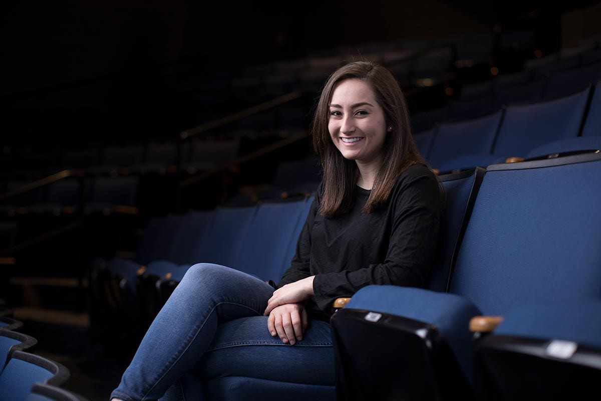Jennifer Dorn '18, a double major in English and theatre arts, in the seats in the Angell Blackfriars Theatre in the Smith Center for the Arts.