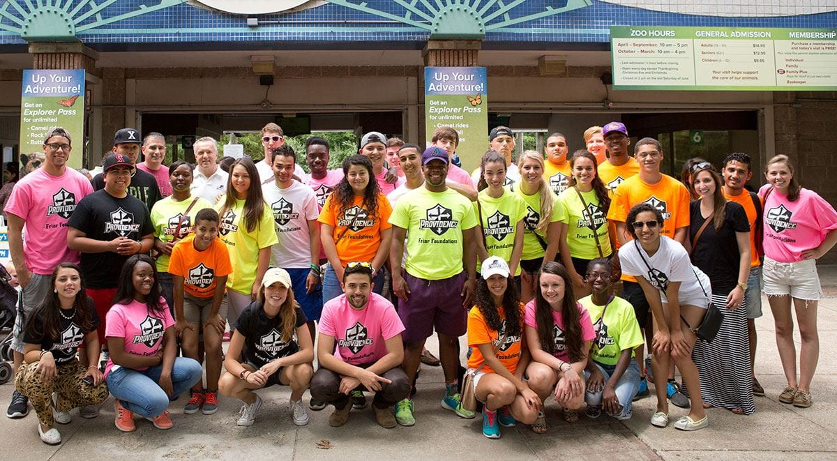 Members of the founding class of the Friar Foundations Program, their student mentors, and other supporters in the College community take a field trip to Providence's Roger Williams Park Zoo in July 2014 as part of program activities.
