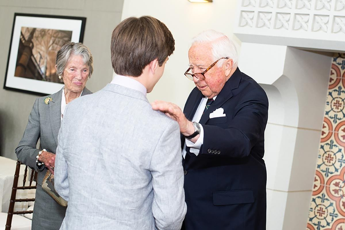 Sam Rachleff of Houston, Texas, talks with David McCullough '18Hon. during the president's reception at the Ruane Center for the Humanities. He is the son of honorary degree recipient Larry Rachleff '18, retired music director of the Rhode Island Philharmonic and Orchestra and a professor at Rice University.