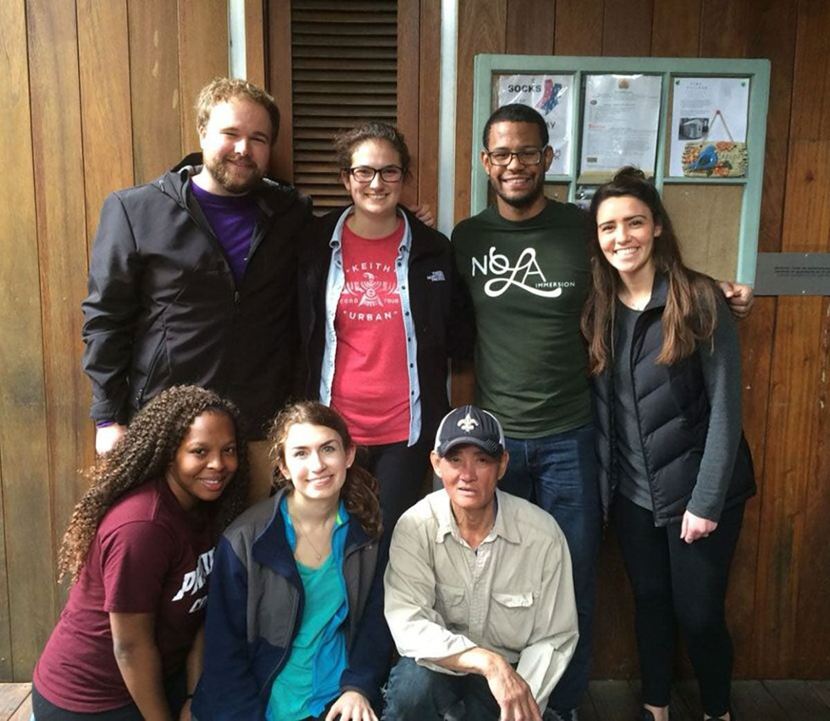 Ron De La Rosa '18, standing, second from right, took part in the NOLA immersion service project in New Orleans over winter break with other PC students and members of the Campus Ministry staff.