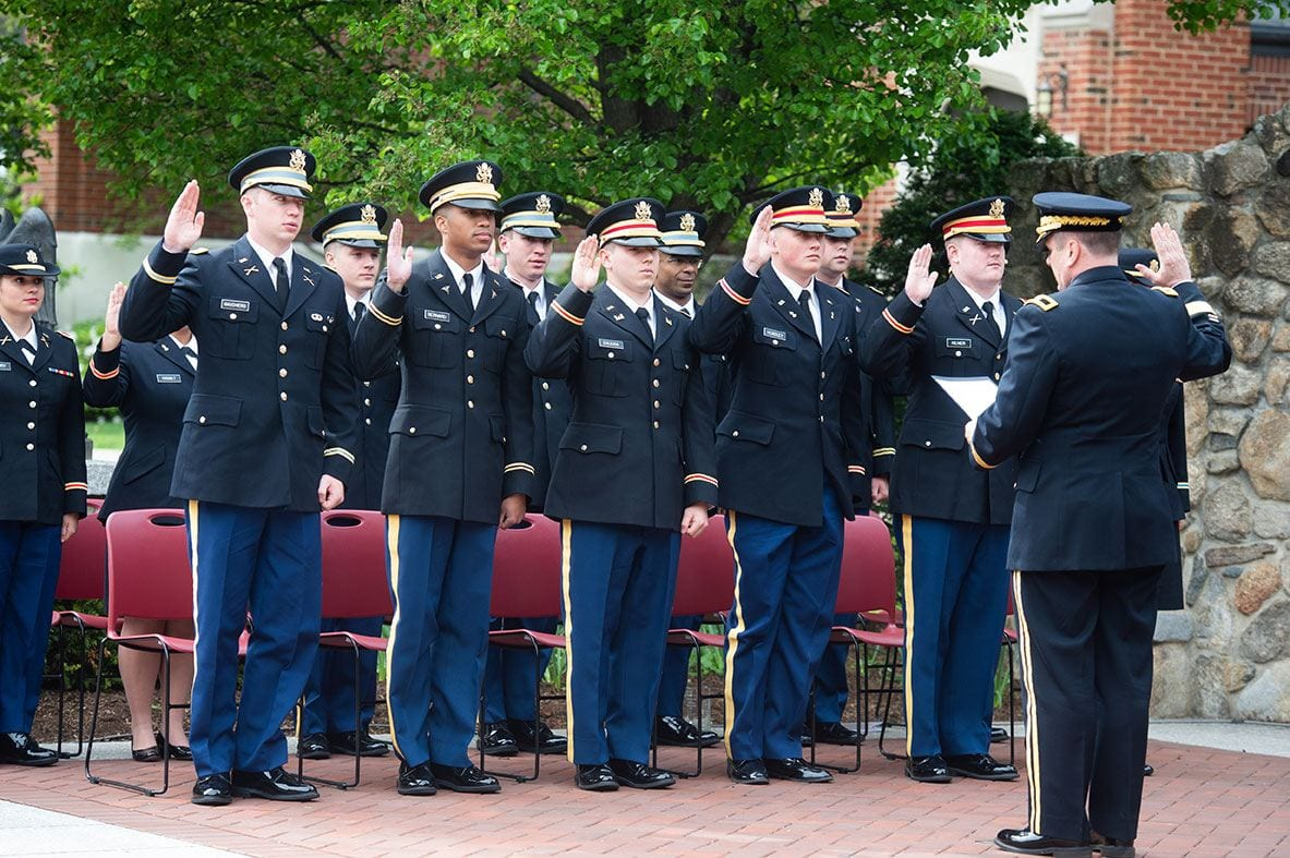 Brig. Gen. Bennett E. Singer of the Rhode Island National Guard administers the oath of office to cadets in the Class of 2018 at the ROTC Commissioning ceremony.