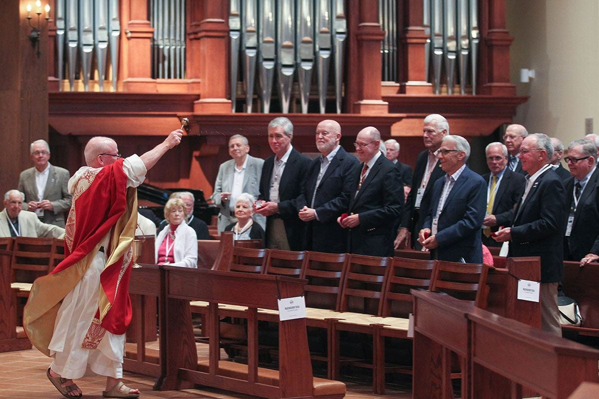 College President Rev. Brian J. Shanley, O.P. '80 blesses Golden Friars and their pins.