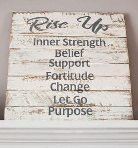 This sign sits on a mantel in the Kanes's home.