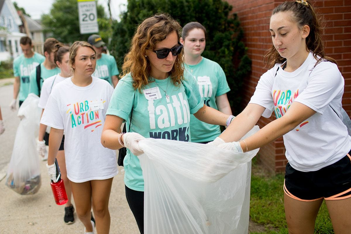 Students pick up trash outside Robert F. Kennedy Elementary as part of the Joint Day of Service.