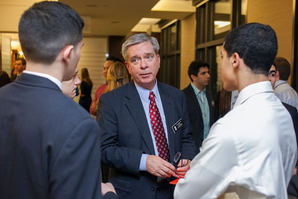 Mark McGwin '81, the new president of the National Alumni Association Council, speaks with students during a networking night when he was president of the Greater Boston Alumni Club.