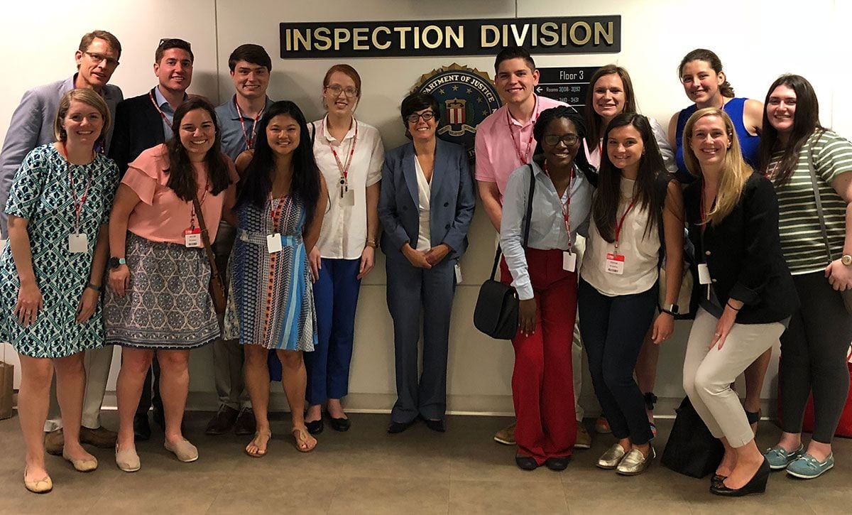 Nancy McNamara '84, assistant director in charge of the FBI's Washington Field Office, center, welcomes Leadership Fellows Program students and College representatives to the J. Edgar Hoover Building.