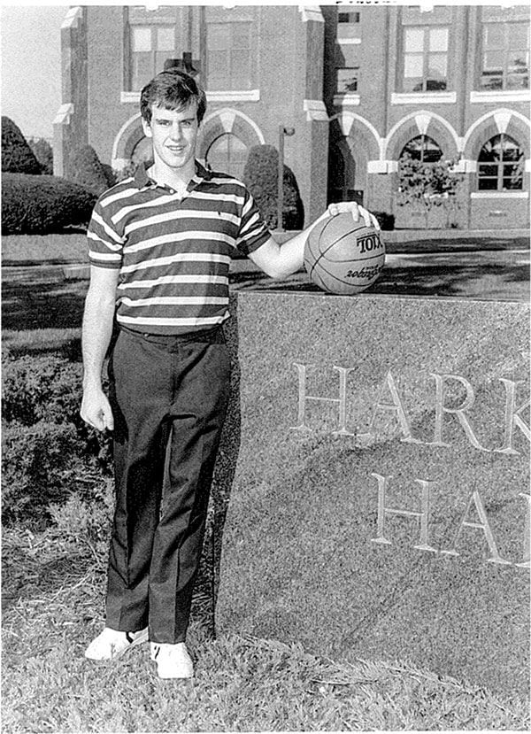 Billy Donovan '87 outside Harkins Hall in a photo from the 1985-86 men's basketball media guide.