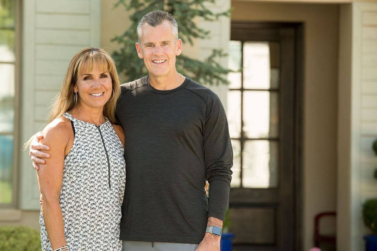 Christine D'Auria Donovan '86 and Billy Donovan '87 outside their home near Oklahoma City.