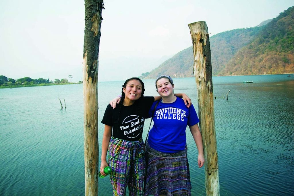 Katherine Martinez '20, left, and Kate Corwin '19 stand at the end of a dock on Lake Atitlán in San Lucas Tolimán.