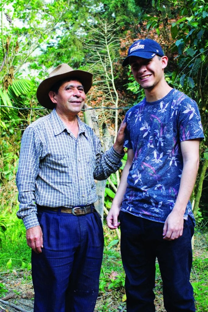 Joshua Santos '20, right, stands beside Toribio, the director of the reforestation project in San Lucas Tolimán.