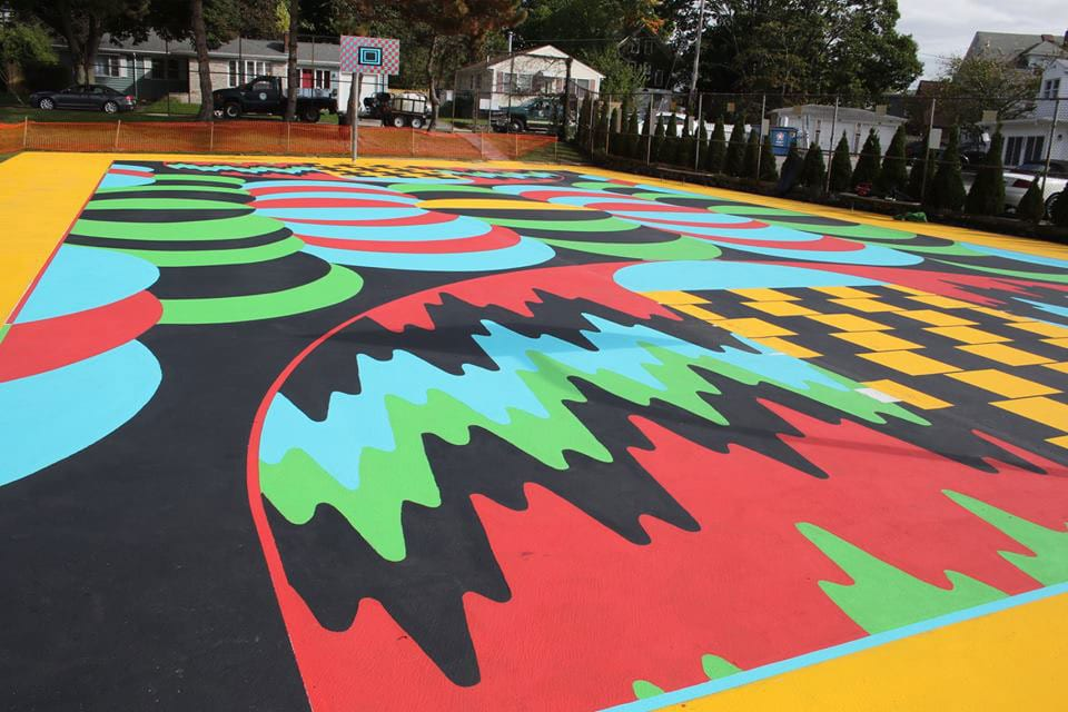 The public basketball courts at Fargnoli Park, near PC's campus, have a bold and vibrant surface, the design of mixed media artist Jim Drain.
