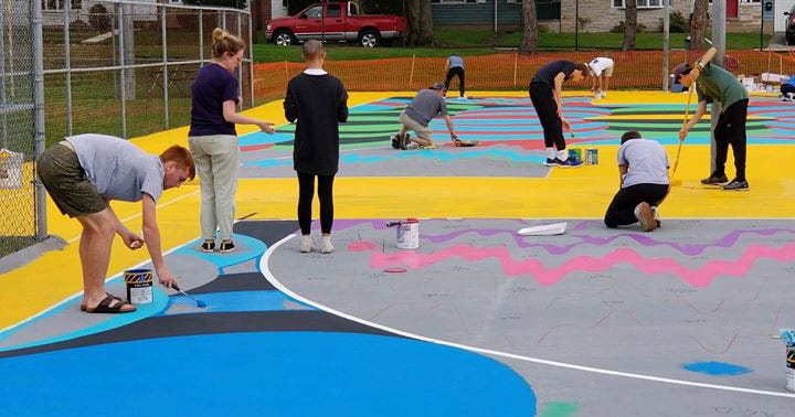 About 130 volunteers, including PC alumni, staff, and students, donated a combined 750 hours to paint two public basketball courts at Fargnoli Park.