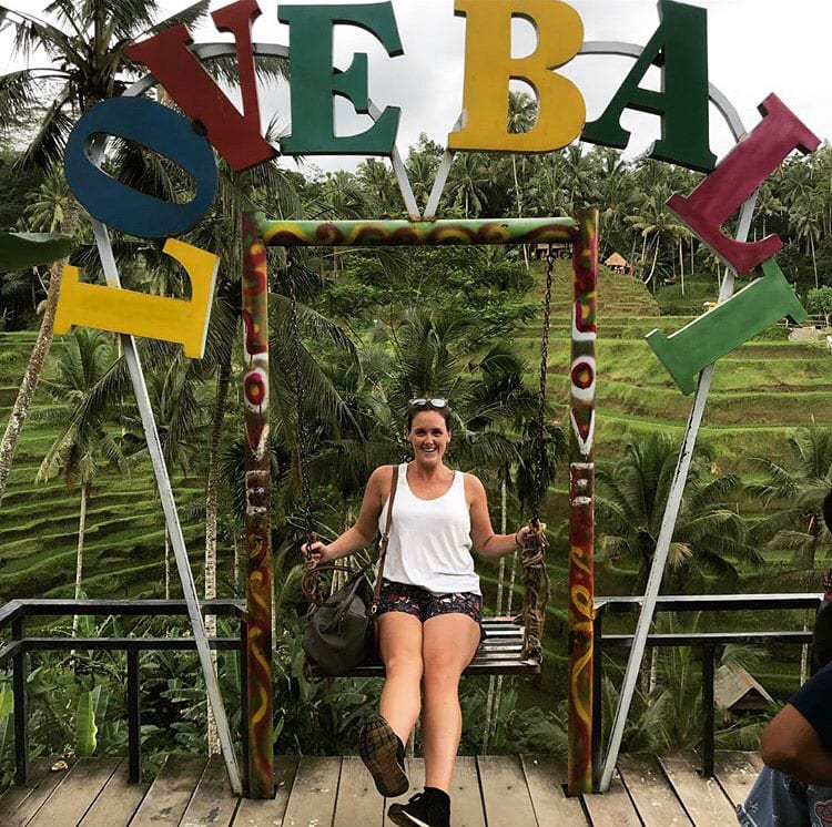 "Susan Malone '13 at the swing and ""Love Bali"" sign at Tegalalang Rice Terraces in Ubud, Bali, Indonesia."