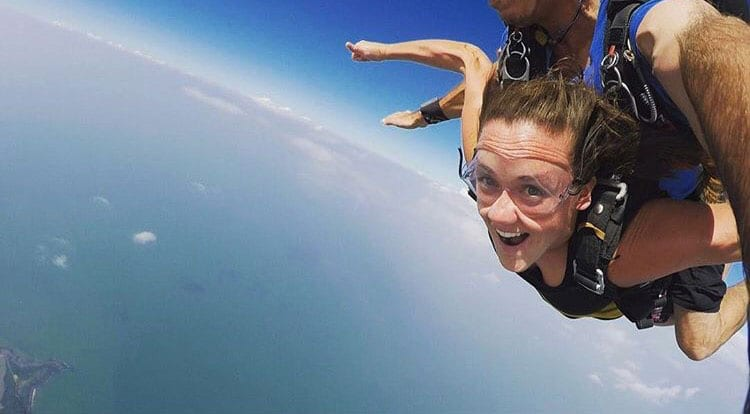 Susan Malone '13 skydiving over Mission Beach, Queensland, Australia, during her working vacation last year.