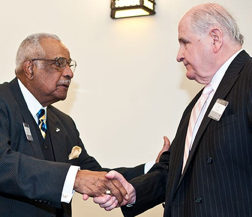 Dr. Kenneth R. Walker, Sr. '57 & '83Hon., left, shakes hands with longtime friend John Murphy at a Walker Family Scholarship Fund reception. Murphy established the scholarship.