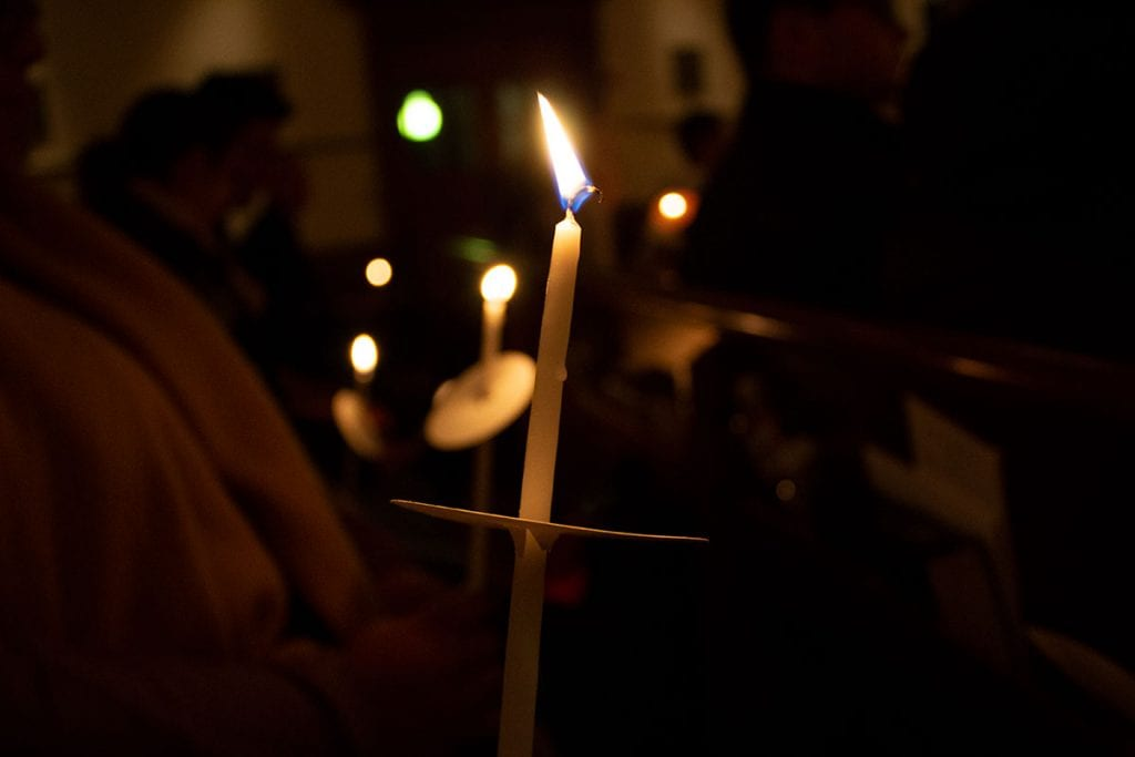 The candlelight vigil in St. Dominic Chapel (Photo by Cristopher Alvarez '22)