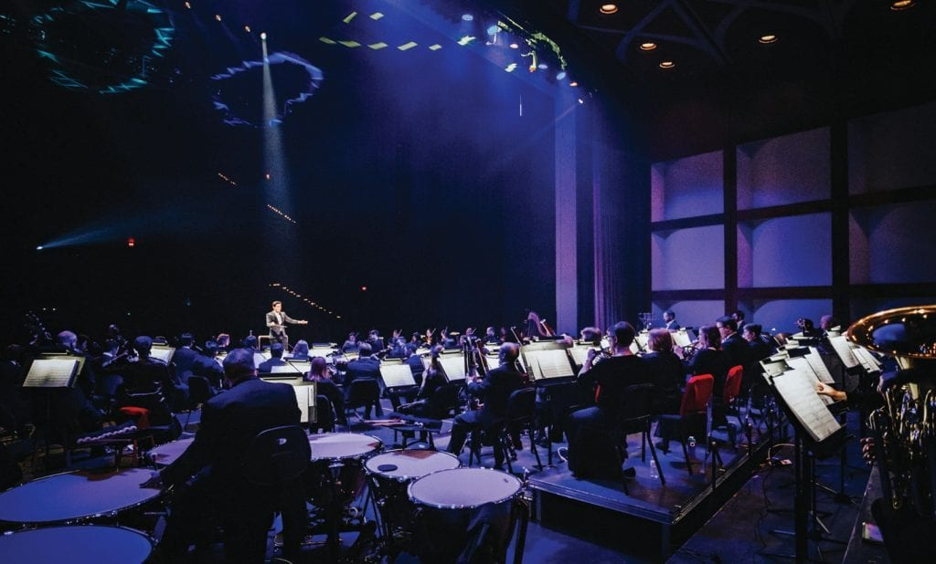 Conducting is art, according to Dr. Troy Quinn '05, shown conducting the Owensboro Symphony Orchestra in Kentucky. He also teaches conducting at the University of Southern California.
