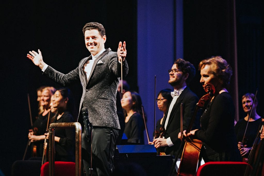 Dr. Troy Quinn '05 acknowledges applause after conducting the Owensboro Symphony Orchestra in Kentucky.