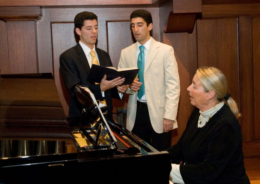 At a dinner to mark the 80th anniversary of Friars Club in 2008, Dr. Troy Quinn '05, left, sang with his brother, Shane Quinn '07, as Sherry Humes Dane, director of liturgical music, accompanied them on piano.