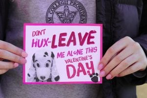 "A person wearing a Providence College shirt holds a valentine that reads ""Don't Hux-Leave me alone this Valentine's Day."""