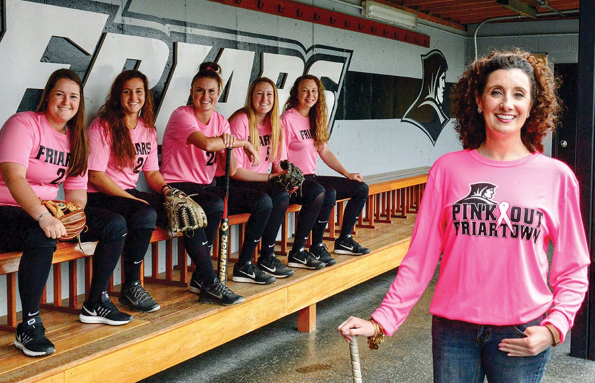 Jennifer A. Rivera '06 & '13G is joined by members of the Friars' softball team in this photo for the 2018-2019 Gloria Gemma Breast Cancer Resource Foundation calendar. With her are, from left, Brittney Veler '18, Taylor Stephen '19, Christina Ramirez '18, Julianne Rurka '18, and Emma Lee '19. (Photo: Lisa Bruno, 64 Degrees Photography)
