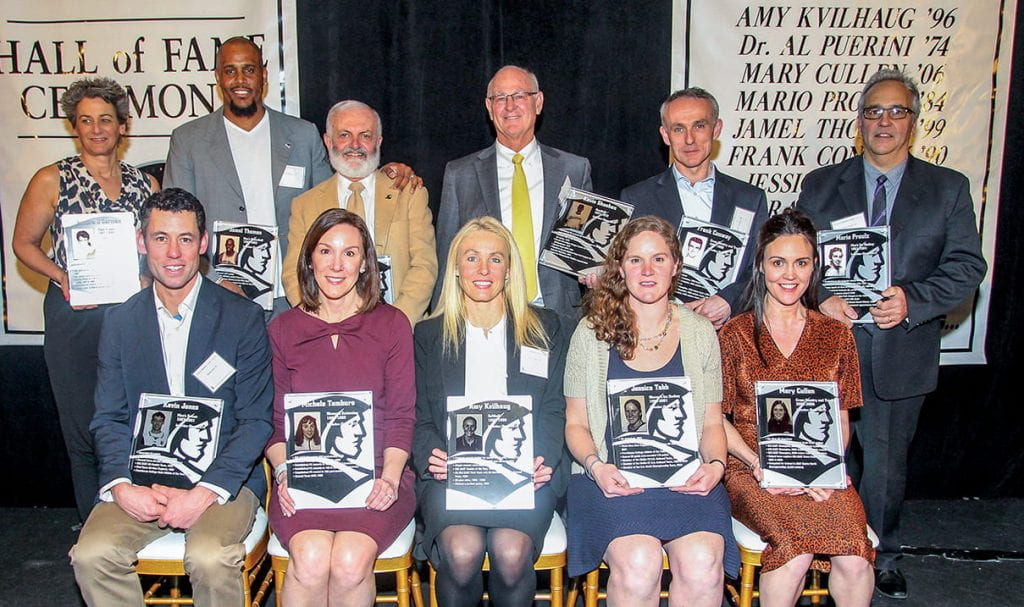 Inductees in the 2019 PC Athletics Hall of Fame class are, front row, from left: Kevin Jones '00 & '06G, Michele Tamburo '95, Amy Kvilhaug '96, Jessica Tabb '01, and Mary Cullen '06. Rear: Sandra O'Gorman '89, Jamel Thomas '99, Albert J. Puerini, M.D. '74, Kevin Sheehan '73 & '78G, Frank Conway '90, and Mario Proulx '84.