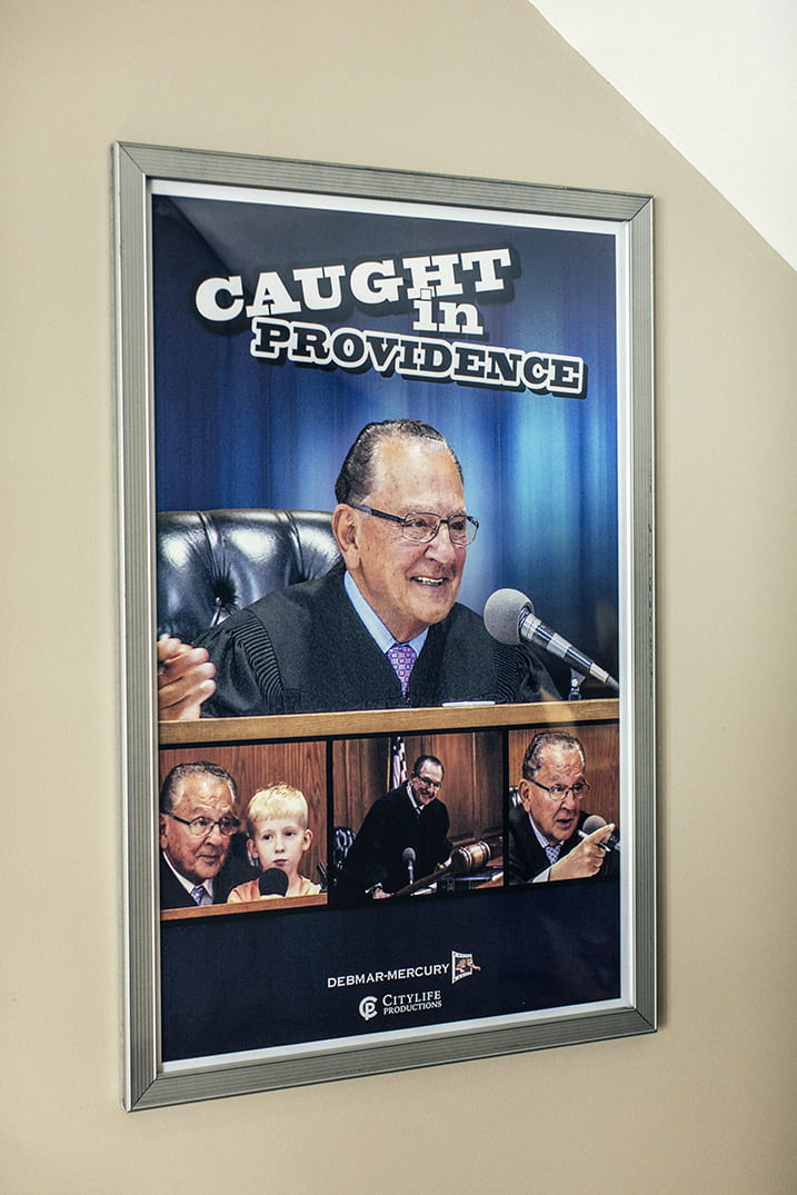 An advertisement for Caught in Providence, the show hosted by Judge Frank Caprio '58 & '08Hon. About 180 local affiliates, including those owned and operated by Fox Television, broadcast the program.