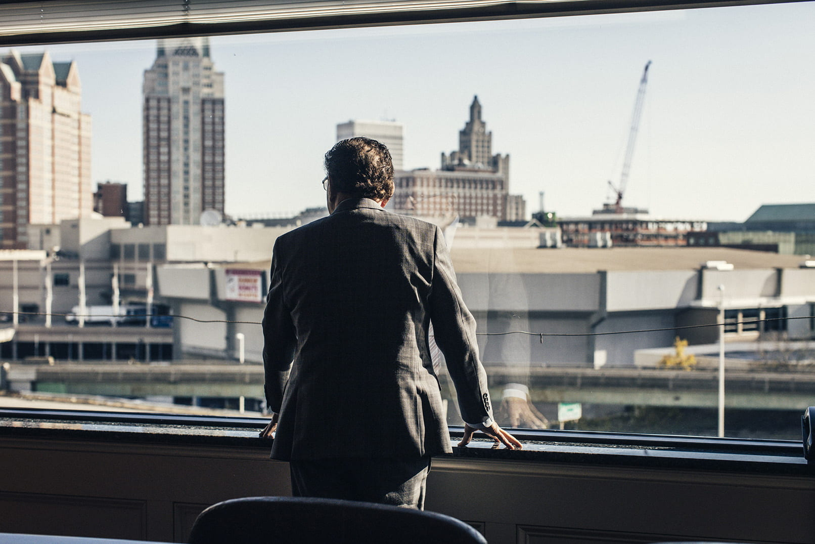 Judge Frank Caprio '58 & '08Hon. surveys downtown Providence from the window of his Federal Hill law office.