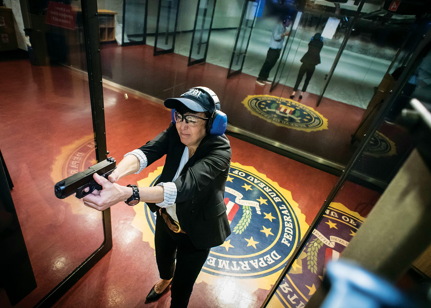 As part of her role as a special agent, Nancy McNamara '84 must undergo a firearms recertification test four times a year. She also must pass a fitness test that includes sit-ups, push-ups, a 300-meter sprint, and a 1.5-mile run.