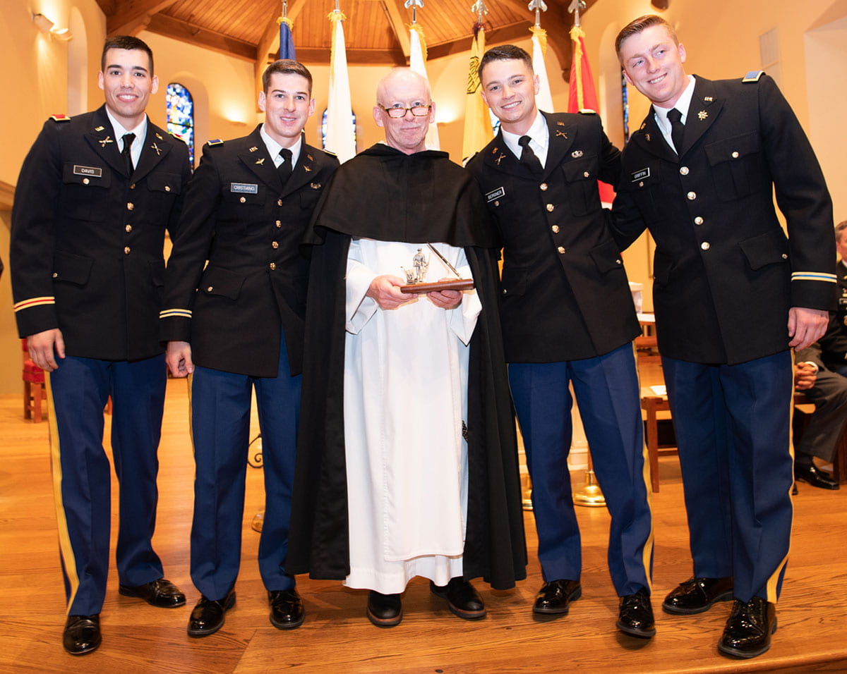 The newly commissioned second lieutenants with College President Rev. Brian J. Shanley, O.P. '80. From left are Marc Davis '19, Ryan Cristiano '19, Justin Bergner '19, and Kyle Griffin '19