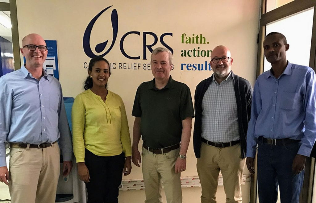 Dr. Terence McGoldrick, center, associate professor of theology at PC, at with the Catholic Relief Services team at the CRS headquarters in Addis Ababa, Ethiopia.