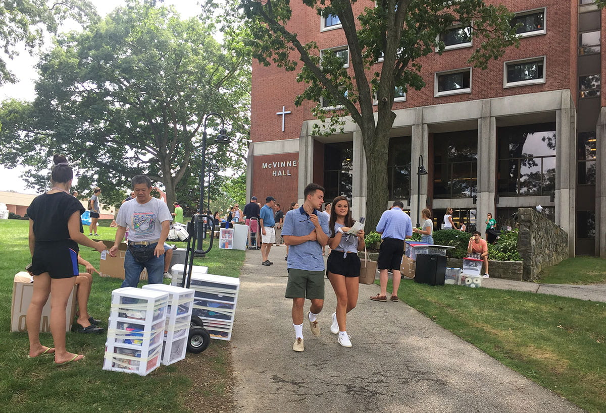 Move-In Day is busy outside McVinney Hall.