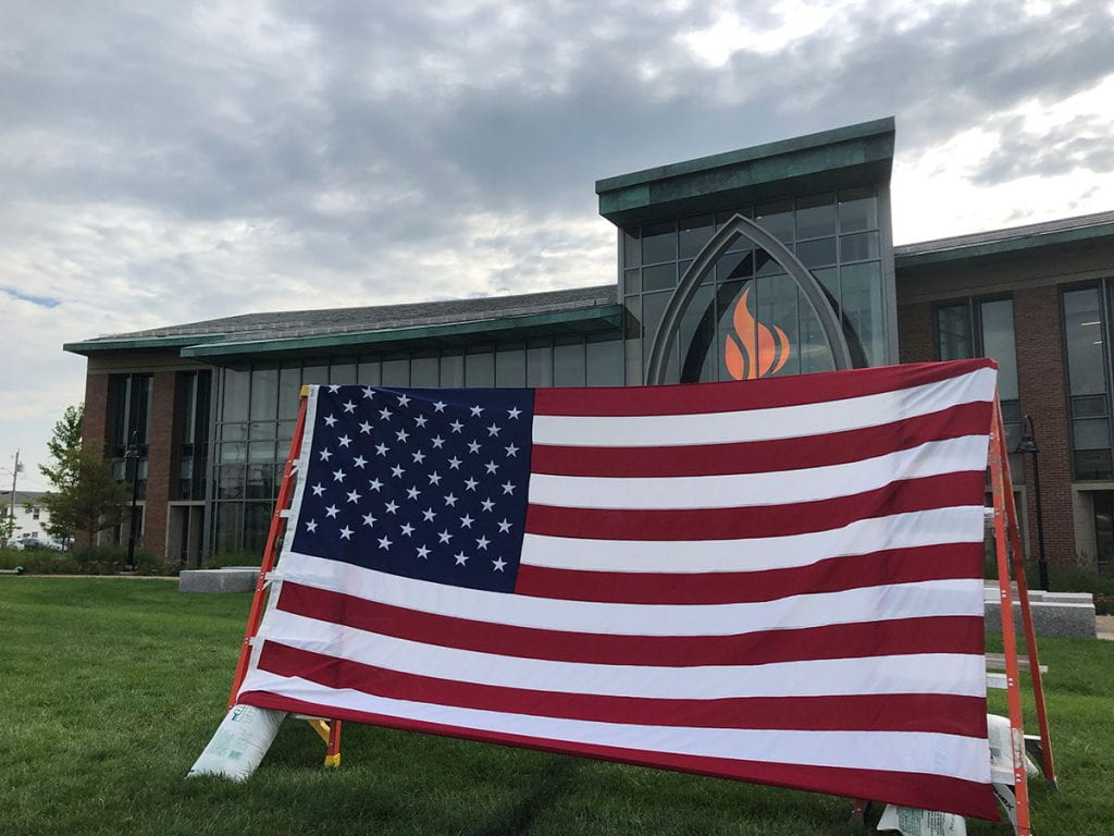 The American flag outside the Arthur F. and Patricia Ryan Center for Business Studies, part of a 9-11 commemoration by College Republicans.