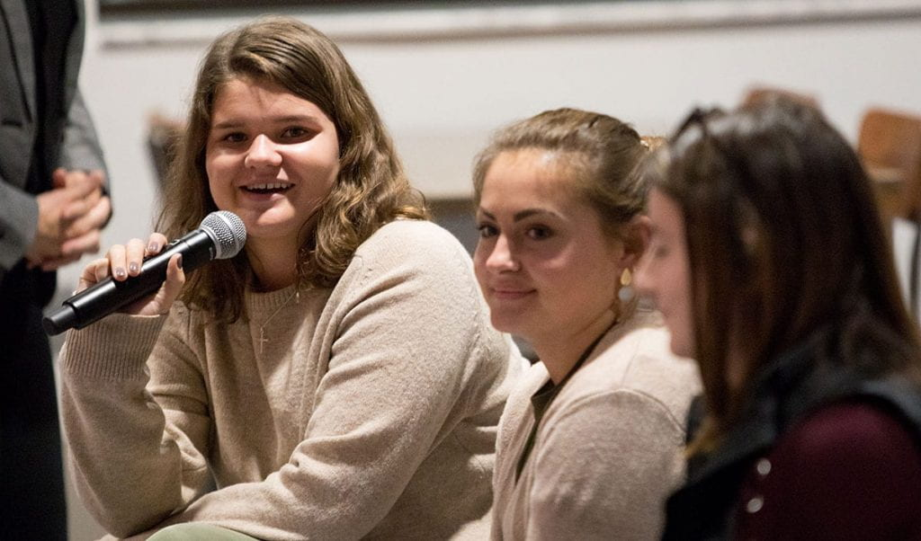 Kathleen Garvey '20, far left, asks a question during the panel discussion.