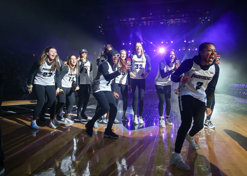 Women's basketball players celebrate at Late Night Madness at the Dunkin' Donuts Center.