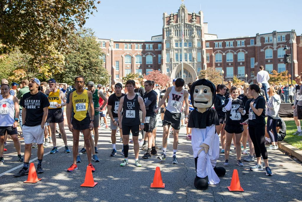 Runners at the starting line in front of Harkins Hall prepare for the 10th annual Friar 5K.