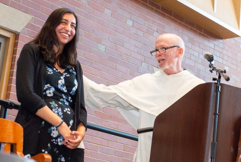 Nicole Jozwik '20, recipient of the Fiondella Student Academic Achievement Award, is congratulated by College President Rev. Brian J. Shanley, O.P. '80.