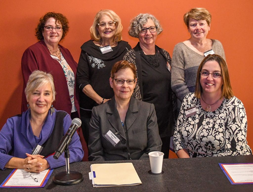 "Participants in the panel on ""Women's and Gender Studies Program: Past. Present. Future."" are, front row from left, Dr. Deborah J. Johnson, Dr. Carmen A. Rolon, and Dr. Maureen C. Outlaw. Rear: Dr. Patricia M. Lawlor, Jane Lunin Perel '15Hon., Dr. Charlotte G. O'Kelly, and Dr. Mary Anne Sedney."
