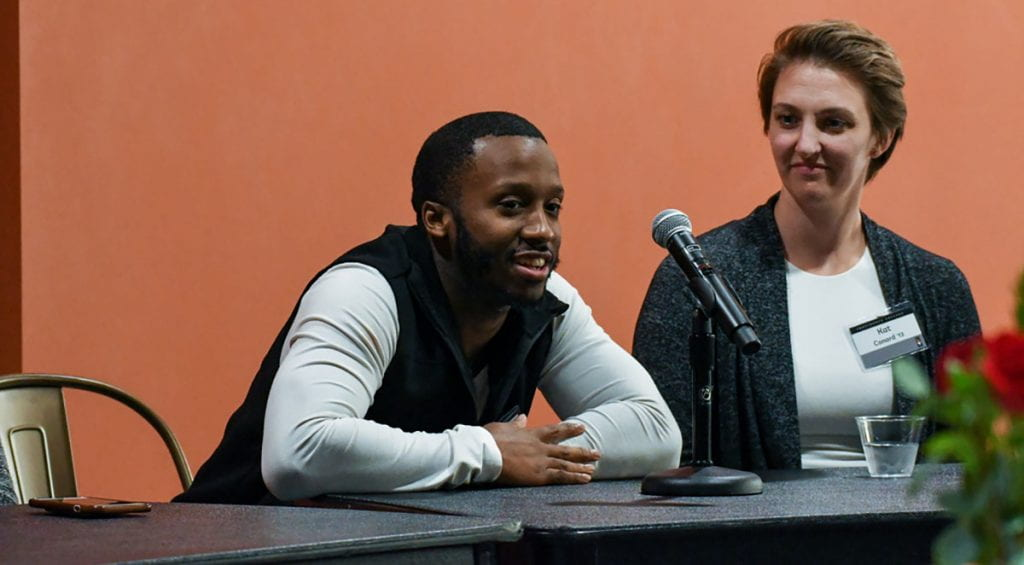"Nicholas Sailor '17 speaks during the ""How We Do Intersectionality"" panel as panelist Kat Conard '13 listens."