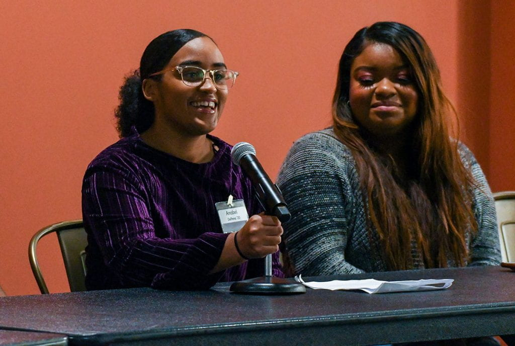 "Anabel DePena '20, left, offers her thoughts during the panel presentation on ""How We Do Intersectionality."" At right is another panelist, Karisneyca Gutierrez '18 & '20G."